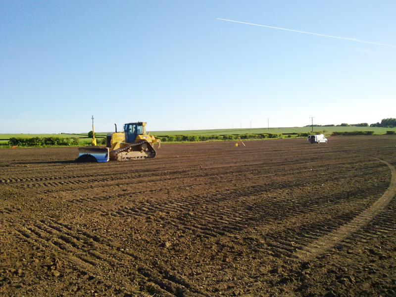 Laser levelling the area using a CAT D6