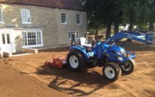 Compact tractor and RotaDairon RD 130 preparing stony soil for grass seeding at Bishop Norton