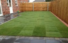 Turfing a new lawn on a development site at Humberston